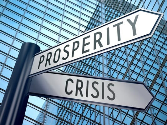 crisis-and-prosperity-street-signs_large.jpg
