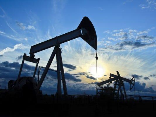 group-of-pump-jacks-drilling-in-silhouette_large.jpg