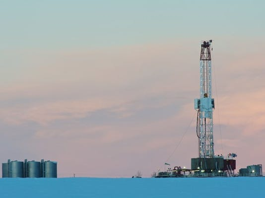 a-natural-gas-drilling-rig-at-dawn-in-a-snowy-field_large.jpg