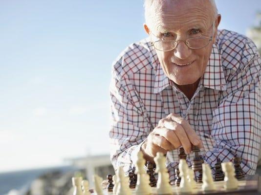 senior-man-playing-chess-on-beach-getty_large.jpg