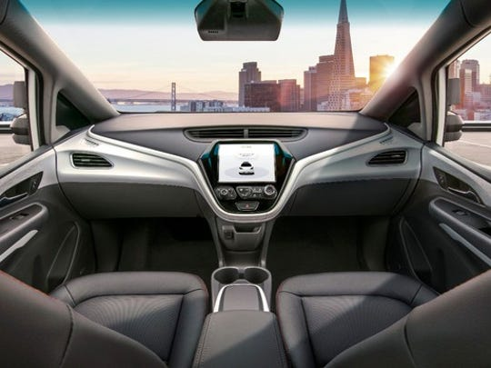 The interior of General Motors' self-driving taxi, called the GM Cruise. GM expects to begin mass-producing the Cruise in 2019.
