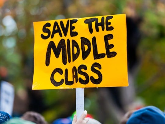 A sign says save the middle class.