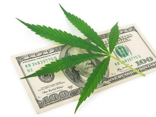 marijuana-leaf-on-top-of-100-bill_large.jpg