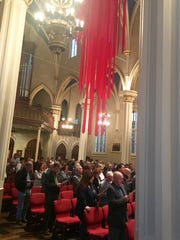 Several hundred people gathered at the Cathedral of