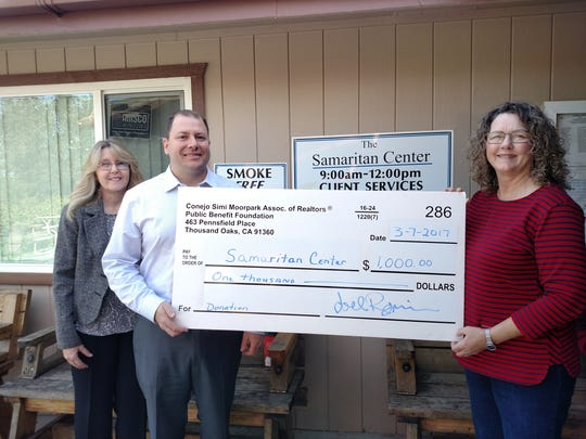 Pictured from left, Evelyn Schultz, CEO of the Conejo Simi Moorpark Association of Realtors Public Benefit Foundation, and Joel Reznick, foundation president, present a $1,000 donation to Betty S. Eskey, executive director of the Samaritan Center of Simi Valley.