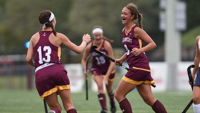 Salisbury's Abbey Shobe (Pocomoke High) celebrates with Casie Preisch after scoring against the College of New Jersey on Saturday at Sea Gull Stadium.