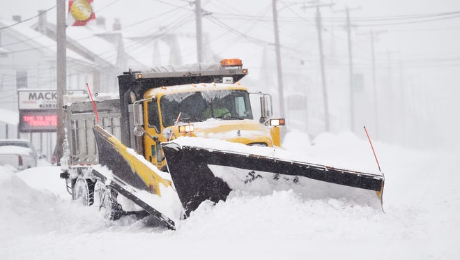 A PennDOT snow plow driver works to clear East Market Street in Hallam Saturday, Jan. 23, 2016. A snow storm affecting much of the East Coast is expected to bring up to 3 feet of snow to York County, Pa., through Saturday evening.