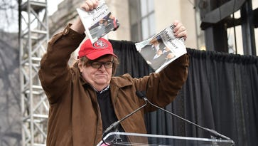 Michael Moore speaks onstage during the Women's March on Washington on January 21, 2017 in Washington, DC.