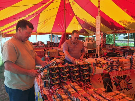 Greg Stith of Weldon in southern Iowa, at left, browses at a fireworks stand in South Lineville, Mo., in June 2016. He is joined by his brother, Brad Stith, an Iowa native who now lives in New Castle, Wyoming,. South Lineville is on the Iowa-Missouri border and has long had a steady stream of  Iowa customers as July 4th approaches each year.