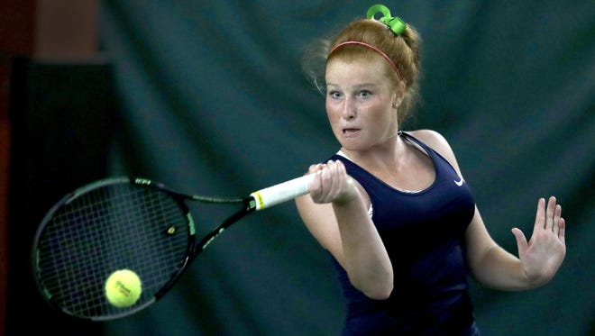 Cathedral's Maeve Koscielski, shown here winning at No. 1 singles in the Irish state championship winning match, added the singles title on Saturday.