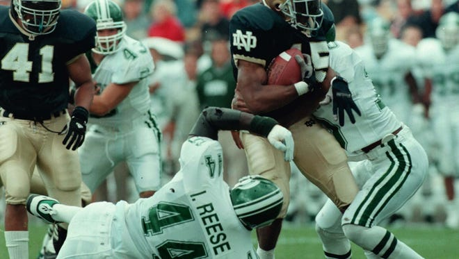 MSU's Ike Reese hauls down Notre Dame's Tony Driver during the Spartans' 23-7 win in South Bend in 1997, the Spartans' first win at Notre Dame since 1983.