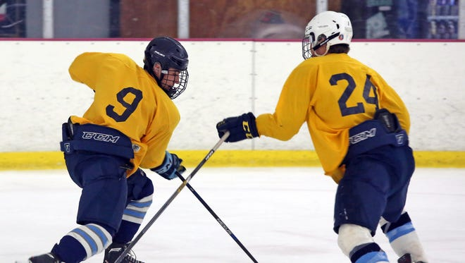 Gib Smith (24) and Ben Hurd (9) during the first day of practice for Pelham hockey team at Ice Hutch in Mount Vernon Nov. 7, 2016.