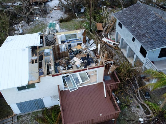 A roof is ripped open in Upper Sugarloaf Key Wednesday, Sept. 13, 2017, days after hurricane Irma ripped through the Florida Keys.