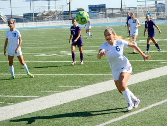 Carlsbad's Madison Austin goes after the ball in the