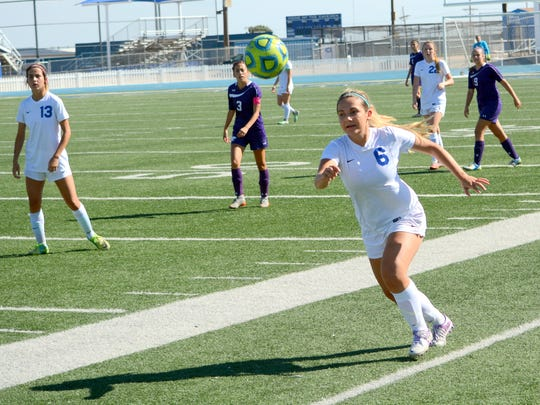 Carlsbad's Madison Austin goes after the ball in the first half Saturday.