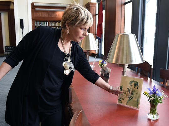 Dara Hooker, daughter of John Jay Hooker, displays photographs of her father for a public service honoring her father at the downtown Nashville Library on Sat., Feb. 6, 2016. John Jay Hooker died  Jan. 24, 2016.
