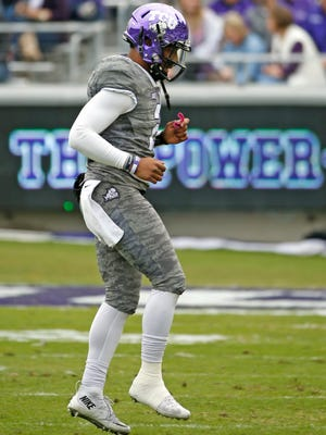 TCU quarterback Trevone Boykin (2) limps toward the sideline after injuring an ankle against Kansas in the first half Saturday.