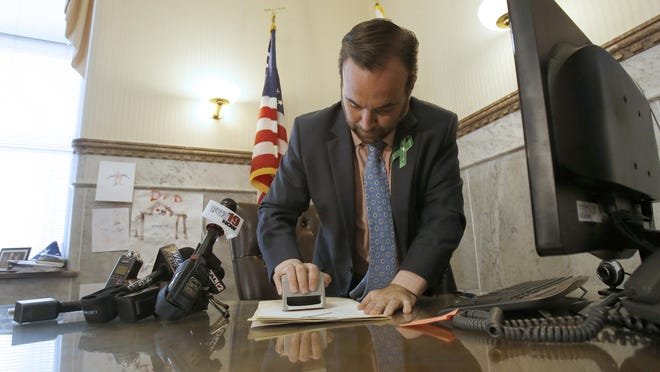 Cincinnati Mayor John Cranley exercised his veto power Wednesday, May 6, 2015, vetoing a plan that would set up an $108-per-year residential parking plan in Over-the-Rhine. It was the first mayoral veto in 10 years.
