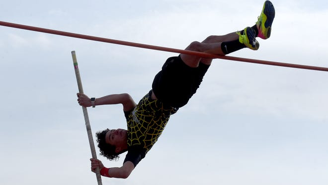 Watkins Memorial's Luke Park vaults during the Dick Houston Relays on Thursday night at Licking Valley High School. Park placed third in the event.