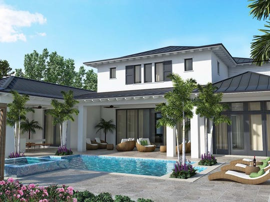 The Cloverdale's custom pool features a swimout and a raised spa with a spillover.