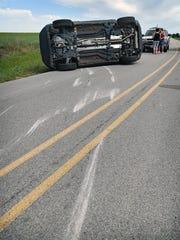 Scraped asphalt indicates where a Jeep SUV slid on