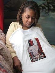 Asbury Park, NJ     Lavon Walker holds a tee shirt