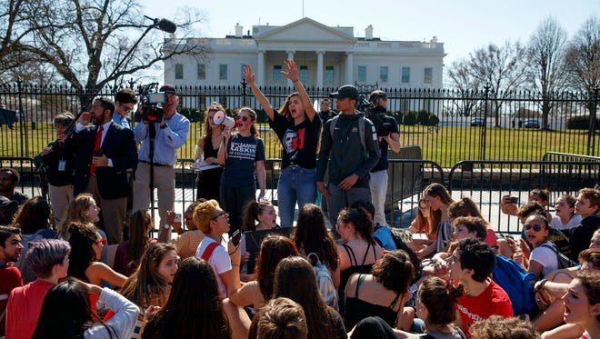 Demonstrators take part in a student protest for gun control legislation in front of the White House on Feb. 21, 2018.