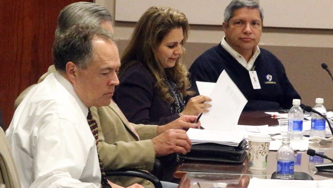 University Medical Center CEO Jim Valenti, foreground, sits in Monday's UMC board meeting where members approved Valenti's annual evaluation and selected four new members and three alternates for the El Paso Children's Hospital Board of Directors.