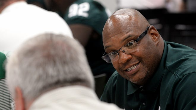 Ron Burton,  the Michigan State defensive line coach  was heading for the middle of the Eastern Seaboard – his native region and one of his recruiting areas for the Spartans.
