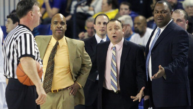 The Delaware basketball coaching staff, (from left) head coach Monte Ross, Phil Martelli, Jr., Jeff Rafferty and Chris Cheeks, argue that time ran out on a Northeastern shot at the first-half buzzer of a 2014-15 game.
