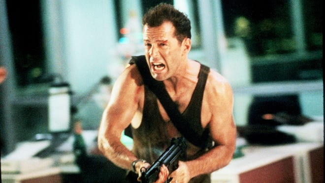 "Bruce Willis takes on a band of thieves trying to steal $640 million in bearer bonds in 1988 film ""Die Hard."""