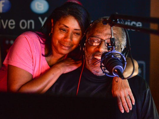 Lugenia Jones, left, hugs her husband Stevie Jones, known as Sir Jones on WLAS FM 95.3 in Anderson, playing old school R&B on Thursday evening. Jones, who plays music live five days a week, learned in October he had diabetes from a trip to the hospital. Jones said anyone with diabetes needs to be a Drum Major to let people they need to be checked for it.
