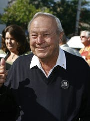 Arnold Palmer, host of the Bob Hope Chrysler Classic 50th Annual golf tournament, gives a thumbs-up to friends at the ceremony to distribute $1.8 million raised in 2008 to Eisenhower Medical Center and 37 other local charities in Old Town La Quinta.