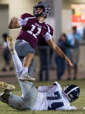 Alabama Christian's Reece Solar punts against Montgomery Academy on the ACA campus in Montgomery, Ala. on Thursday November 2, 2017.