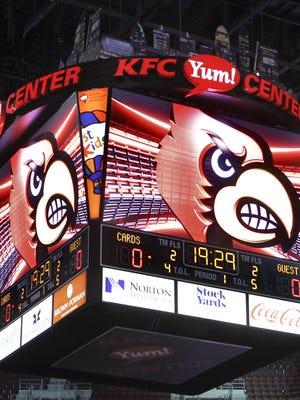 The UofL scoreboard at the KFC Yum! Center. (File)