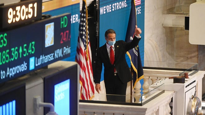Amid the ongoing COVID-19 pandemic, Governor Andrew M. Cuomo rings the opening bell at the New York Stock Exchange, with NYSE President Stacey Cunningham Tuesday morning May 26, 2020. The floor of the NYSE had been closed to traders since March 23, 2020. Today, it was re-opened for up to 25% capacity.