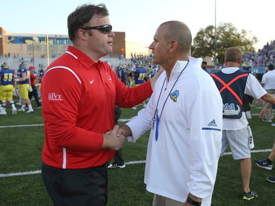 Head coaches of David Archer of Cornell (left) and Danny Rocco of Delaware meet after Delaware's 41-14 win at Delaware Stadium Saturday.