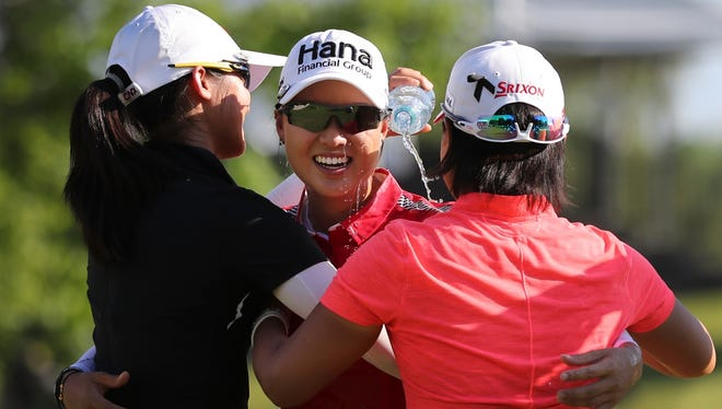 Minjee Lee, center, of Australia, is doused with water after winning the LPGA Volvik Championship golf tournament on the final hole at the Travis Pointe Country Club, Sunday, May 27, 2018, in Ann Arbor.