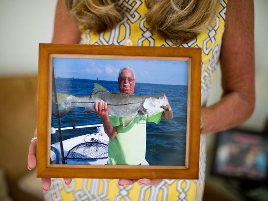 David Trudell is seen in this photo from May 2015, holding a snook he caught in the Indian River Lagoon in Fort Pierce. His widow, Delta Trudell, holds his photo during an interview April 11, 2016, at home in Port St. Lucie.