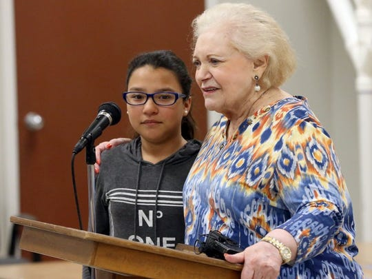Holocaust survivor Leah Goltzman (right) speaks after Kasandra Trevino asked her if she had a tattoo on her arm Wednesday at the Jewish Community Center. Goltzman said she did not have numbers on her arm, because she was not in a death camp.