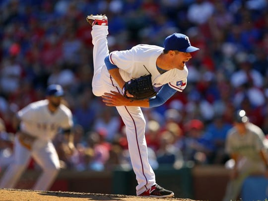 Texas Rangers starting pitcher Cole Hamels (35) follows through on a pitch against the Seattle Mariners during the fifth inning on Monday, April 4, 2016, at Globe Life Park in Arlington, Texas. (Tom Fox/Dallas Morning News/TNS)