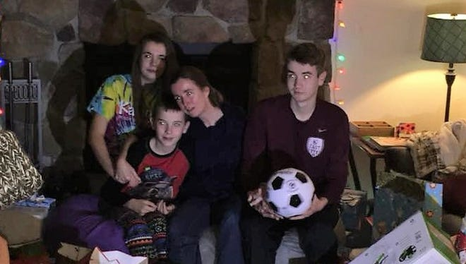 The Seaver family, including Shannon, Liam, mom Colette, and Aidan, open a few gifts from the Mojo in the Morning radio show. Colette's husband, Patrick is a cancer patient and unable to work while being treated for the disease.