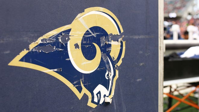 A detailed view of the Rams logo on the side of an equipment trunk on the sidelines at Paul Brown Stadium.