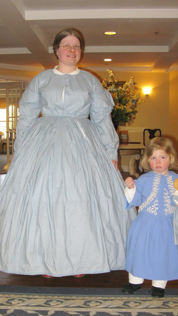 Lisa and her daughter, Rebecca, model some 19th century dresses at Legacy's Fashion Show.