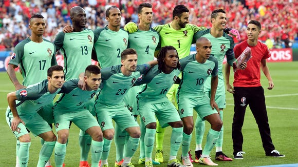 Portugal's Cristiano Ronaldo, 2nd right, laughs as