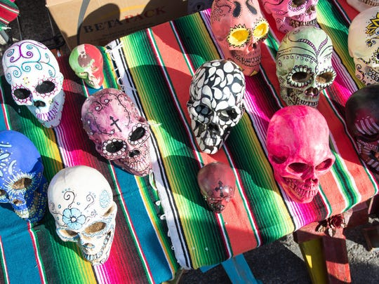 A vendor displays their hand crafted work during the annual Dia De Los Muertos Festival in Corpus Christi on Saturday.