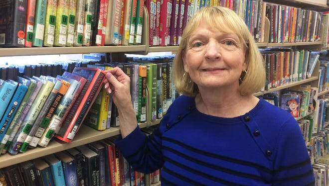 Sharon Bernhardt has spent her 50-year career working for the Indianapolis Public Library.