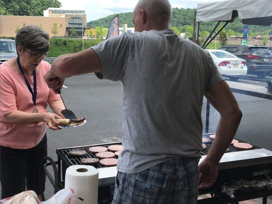 Carol Venes of Mountainside enjoys the barbecue at