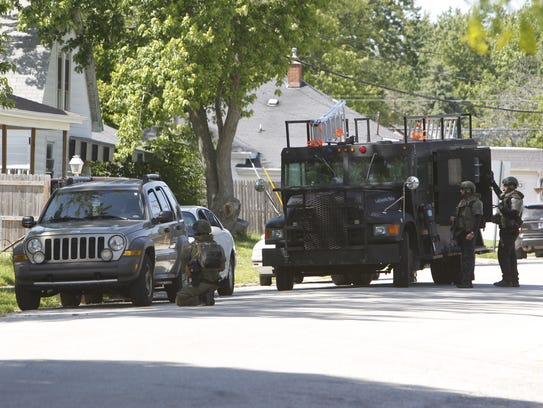 Lafayette police tactical team members surrounded a