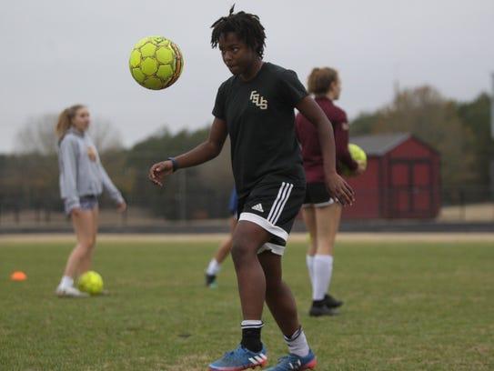 Janae Scott and the Florida High girls soccer team